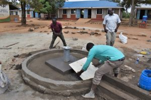 The Water Project:  Affixing The Tile