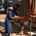 The Water Project: Ibokolo Primary School -  Changing Drilling Rod