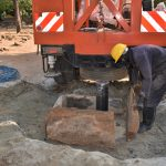 The Water Project: Ibokolo Primary School -  Constructing Temporary Pad