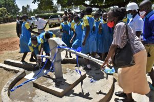 The Water Project:  A Parent Pumping Water From The Borehole