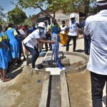 The Water Project: Ibokolo Primary School -  Field Officer Janet Celebrates Water From The Well