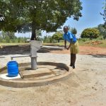 The Water Project: Ibokolo Primary School -  Jeff Fetching Water