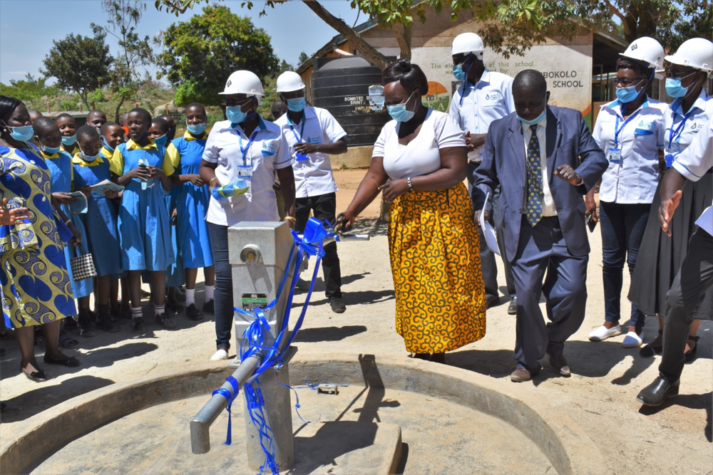 The Water Project : kenya21201-madam-chief-cutting-the-ribbon-to-officially-launch-ibokolo-primary-well