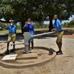 The Water Project: Ibokolo Primary School -  Pupils Drinking Clean Water