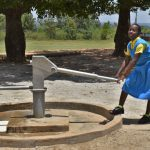 The Water Project: Ibokolo Primary School -  Sharon Pumping Water