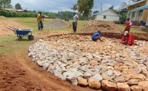 The Water Project:  Laying Rock Foundation