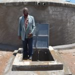 The Water Project: Gidimo Primary School -  Teacher Tom Nyambetsa At The Rain Tank