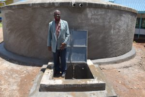 The Water Project:  Teacher Tom Nyambetsa At The Rain Tank