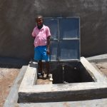 The Water Project: Gidimo Primary School -  Clinton At The Rain Tank