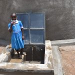 The Water Project: Gidimo Primary School -  Drinking Water From The Tank