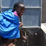 The Water Project: Gidimo Primary School -  Fetching A Drink From The Tank