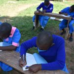 The Water Project: Gidimo Primary School -  Students Taking Notes At Training