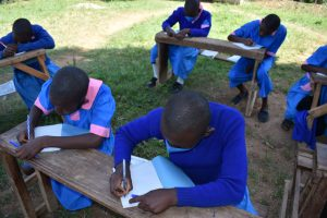 The Water Project:  Students Taking Notes At Training