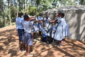 The Water Project:  Health Club Members Having Fun At The Rain Tank