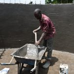 The Water Project: Jimarani Primary School -  Mixing Cement For The Smooth Layer Of The Wall