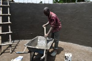 The Water Project:  Mixing Cement For The Smooth Layer Of The Wall