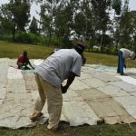 The Water Project: Jimarani Primary School -  Sewing The Sugarsacks To The Dome Frame