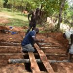 The Water Project: Jimarani Primary School -  Laying Poles To Support Latrine Foundation