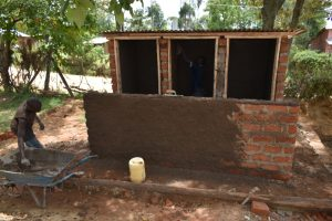 The Water Project:  Plastering Latrines