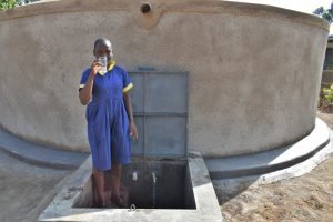 The Water Project:  A Girl Holding Up A Glass Of Water