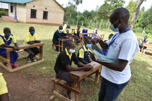 The Water Project:  Distributing Writing Materials