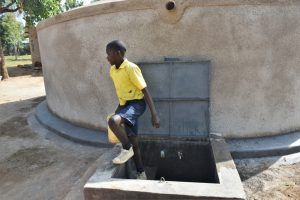 The Water Project:  Leaving The Rain Tank With Water