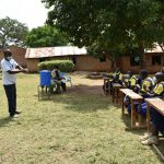 The Water Project: Jimarani Primary School -  Facilitator Leads The Handwashing Session