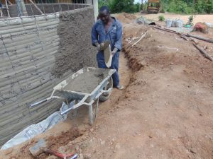 The Water Project:  Plastering Outside