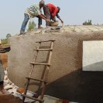 The Water Project: Kitambazi Primary School -  Laying The Dome