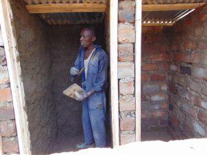 The Water Project:  Plastering Interior Latrine Walls