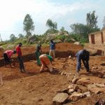 The Water Project: Kitambazi Primary School -  Aligning Stone Foundation