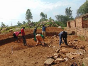 The Water Project:  Aligning Stone Foundation