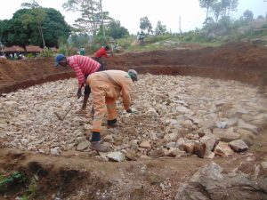 The Water Project:  Breaking Down The Rocks To Create Level Surface