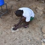 The Water Project: Kitambazi Primary School -  Breaking Down Charcoal For Dental Hygiene Session