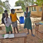 The Water Project: Kitambazi Primary School -  Demonstrating Charcoal And Chewing Stick Use As Toothpaste And Brush Alternatives