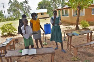 The Water Project:  Demonstrating Charcoal And Chewing Stick Use As Toothpaste And Brush Alternatives