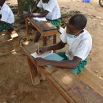The Water Project: Kitambazi Primary School -  Students Taking Notes