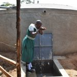 The Water Project: Kitambazi Primary School -  Taking A Sip Of Water