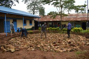The Water Project:  Laying Stone Foundation