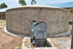 The Water Project:  A Happy Girl Plays With The Water