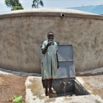 The Water Project: Friends Musiri Primary School -  A Pupil Drinking Water From The Water Point