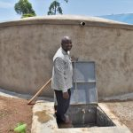 The Water Project: Friends Musiri Primary School -  Mr Duncan At The Rain Tank