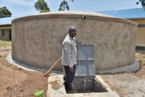 The Water Project:  Mr Duncan At The Rain Tank
