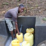 The Water Project: Emutetemo Community, Lubale Spring -  Kellian Fetching Water