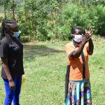 The Water Project: Emutetemo Community, Lubale Spring -  Madam Zaituni Showing The Proper Steps Of Handwashing