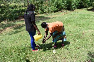 The Water Project:  Madam Zaituni Showing The Proper Steps Of Handwashing