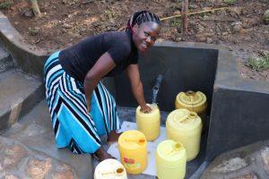 The Water Project:  Selpher Keya Shiundu Fetching Water