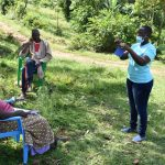 The Water Project: Emutetemo Community, Lubale Spring -  Trainer Jacky Leads Mask Making Session