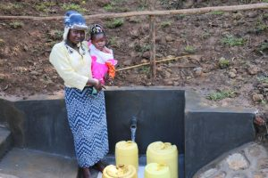 The Water Project:  A Mother With Her Baby At The Spring
