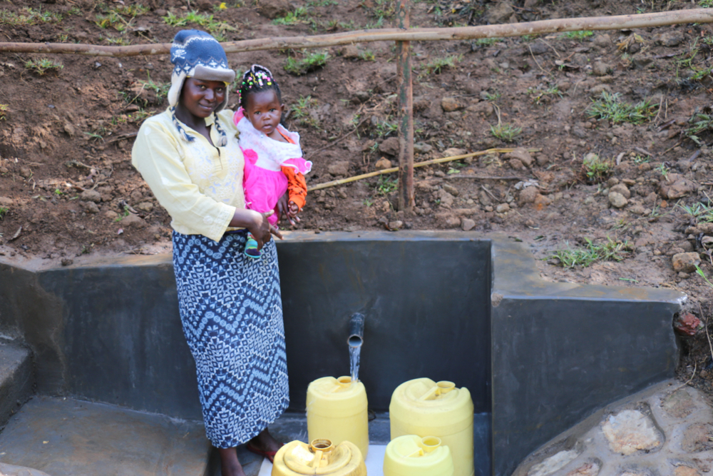 The Water Project : kenya21301-a-mother-with-her-baby-at-the-spring